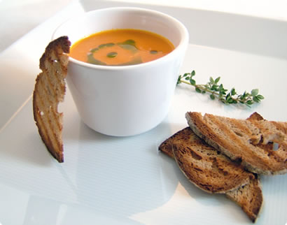 Roasted Orange Pepper Tomato Soup with Basil Oil and Bread Chips